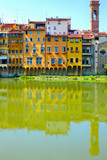 Florence medieval colorful buildings reflect on the river