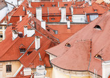 Aerial view of the colorful orange roofs of old houses in the city of Europe Prague.