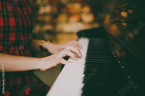 woman hands playing piano