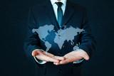 Businessman holding world map.