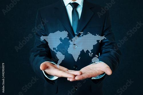 Businessman holding world map. Poster