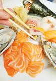 dish of sushi, sashimi,oyster and japanese food