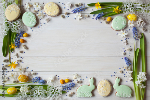 Poster Easter background with flowers hyacinths and cakes in the form of eggs and rabbi