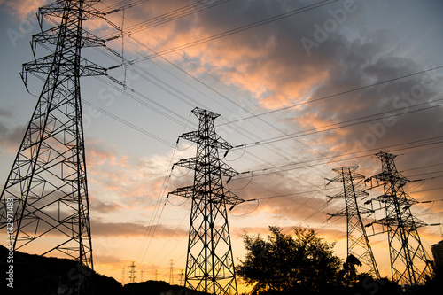 Poster high voltage post at sunset.