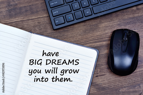 Text Have Big dreams you will grow into them on notepad