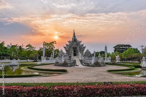 Wat Rong Khun()at sunset in Chiang Rai,Thailand Poster