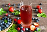 Fresh berry drink with strawberries, blueberries, blackberries and raspberries