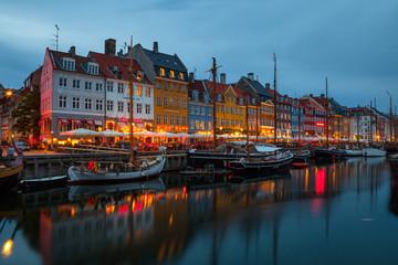 COPENHAGEN, DENMARK - 25 JUN 2016: Fairy tale Nyhavn canal at blue hour, illumanated houses and street