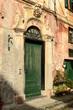 sunny entrance portal, Finalborgo, Italy