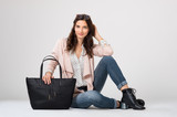 Fashion woman sitting - 143012465