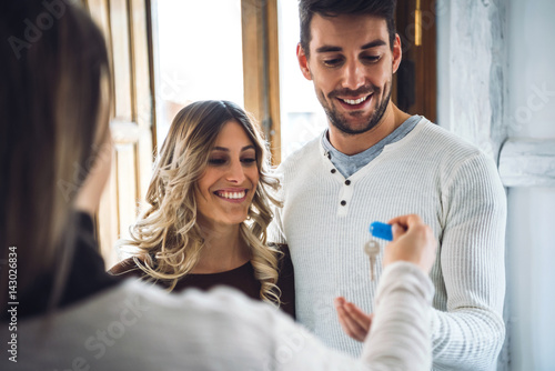 Happy young couple buying real estate