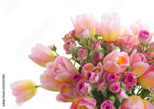 Bouquet of fresh pink and yellow tulips and roses isolated on white background