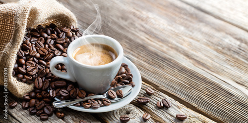 Wall mural Espresso Coffee Cup With Beans On Vintage Table