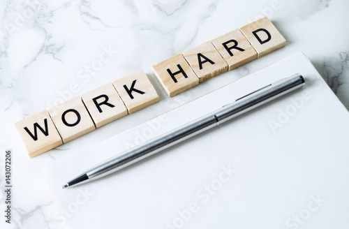 Poster Workaholic text on blank notebook on luxury marble table
