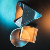 Composition of geometric shapes of glass on a background of colored ceramics. Cubism and formalism in photography