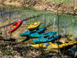 Six Kayaks Lined Up along the creek red blue yellow