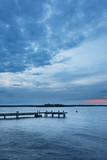 Pastel sunset over Swedish Stockholm archipelago coastal landscape with jetty