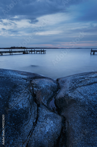 Fotobehang Stockholm Long exposure of Swedish archipelago coastal landscape with cliffs and jetty