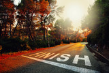 Sunset countryside asphalt road with finish line message on the floor. - 143127897