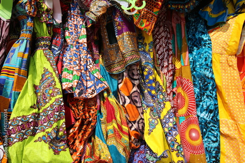 Fototapeta Traditional African Textiles / Beautiful decorated stalls offer colorful African Textiles in Lomé, Togo, West Africa.