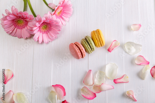 Macaroon cakes with pink rose petals and Gerbera flowers Poster