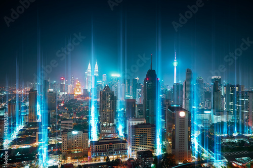 Foto op Canvas Kuala Lumpur The network light came out from the ground ,modern city with wireless network connection concept , abstract communication technology image visual .