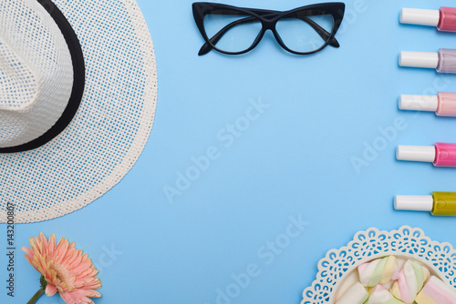 Stampa su Tela Flat lay of feminine collection of hat, glasses and nail polishes