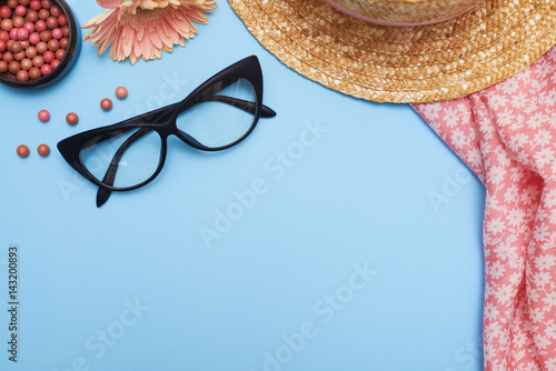 Poster Woman accessories, clothes and cosmetics on blue background, flat lay