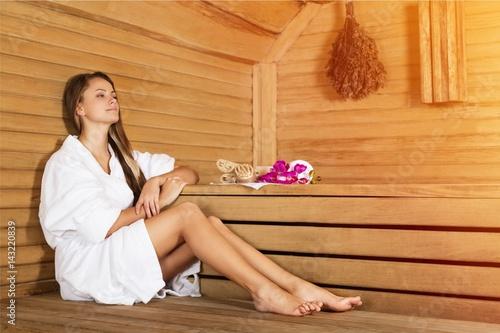 Woman in sauna.