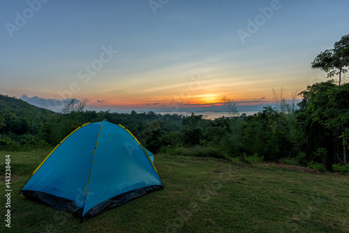 Tourist tent in camp among meadow in the mountain at sunrise Poster