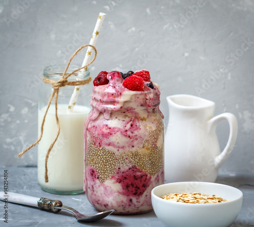 Foto op Aluminium Milkshake Berry smoothie in a jar (raspberry milkshake) with milk, bananas and chia.