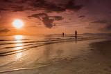 people meet the sunset on the beach