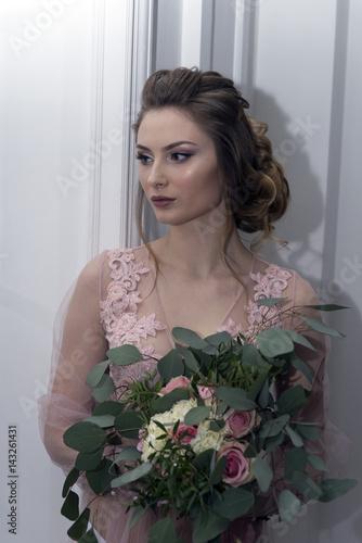 bride's morning. Young girl posing in pink sheer nightie Poster