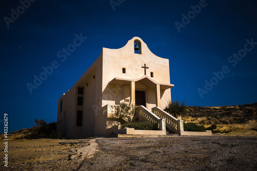 Gozo, Malta - The Saint Anne or Sant' Anna Chapel at Dwejra bay by night on the Poster