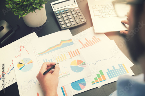business analysis - man working with financial data charts at office