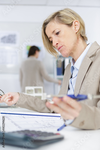 woman accountant calculating taxes - 143294628