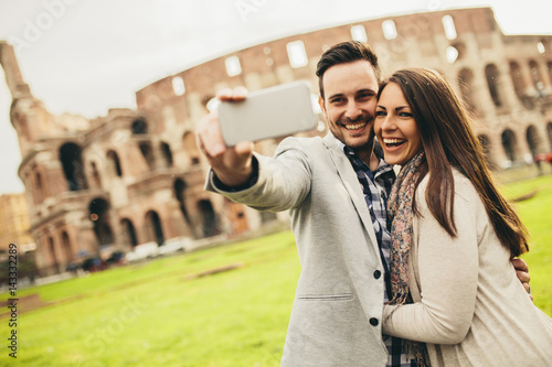 Couple taking selfie in Rome, Italy Poster