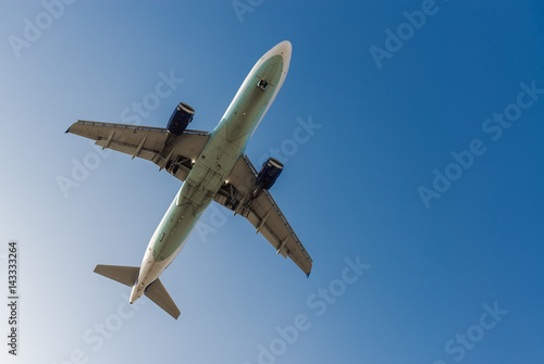 Poster Airplane in the blue sky