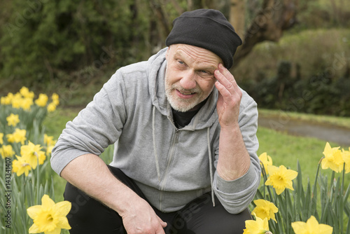 Mature man taking a break after running in the park Poster