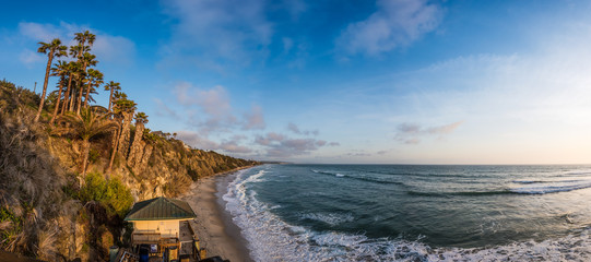 A Panoramic View of Swami's Beach with Cliffs at Sunset