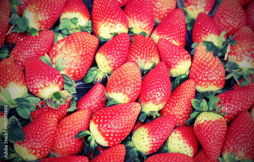 background of red strawberries for sale with old effect