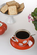 Red cup of coffee and french crackers