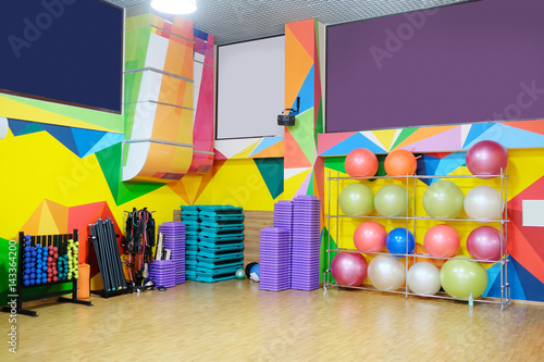 Fitness or dance hall with fitness equipment