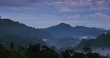 Timelapse of moving clouds above hills, mountains of rural Sri Lanka countryside at early morning in Ella - 143365873