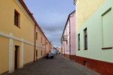 Old narrow street of Grodno with colorful houses in perspective. Belarus.