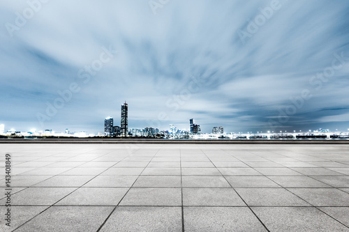 empty brick floor with cityscape and skyline Poster