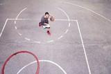 Basketball player outdoor practicing. Street ball.