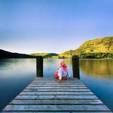 a girl setting on jetty
