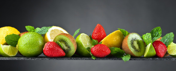 Ripe juicy fruits and peppermint with water drops © Igor Normann