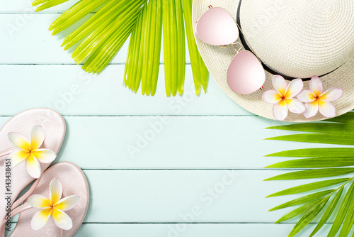 palm leaves and beach accessories on the wooden board